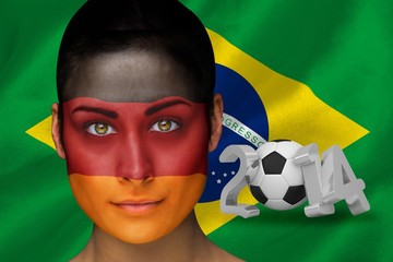 Composite image of german football fan in face paint