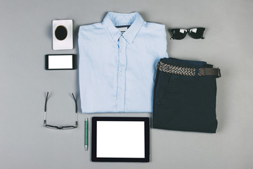Outfit of business man on grey background.