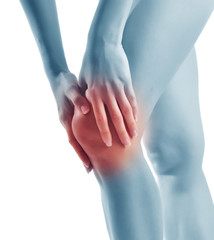 Acute pain in a woman knee. Female holding hand to knee-aches.