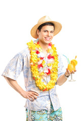 Man in Hawaiian clothes holding a cocktail