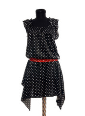 Polka dots dress with red belt on mannequin. Tailor's dummy.