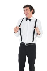 Groom stretching his suspenders