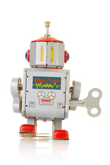 Robot clockwork vintage toy on white, clipping path