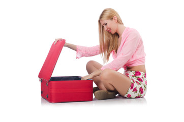 Attractive woman  preparing for vacation with suitcase isolated