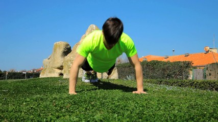 Athlete doing pushup outdoors tracking shot