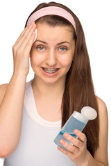 Girl with braces cleaning face isolated