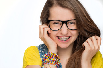 Girl with braces wearing geek glasses isolated