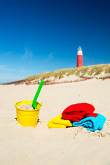 Beach with toys and lighthouse