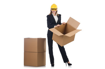 Woman builder with boxes isolated on white