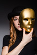 Redhead woman in hat  iwith mask in hypocrisy consept against da