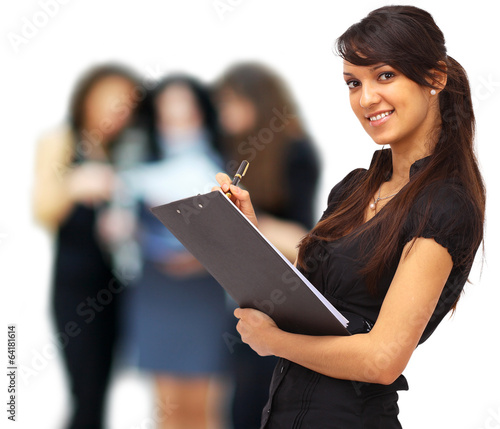 Charming girl holding a folder and looking at camera