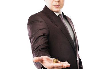 businessman holding coins in his hand isolated