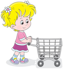 Little buyer going with a supermarket trolley