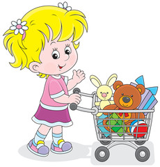 Little buyer with a shopping trolley of toys