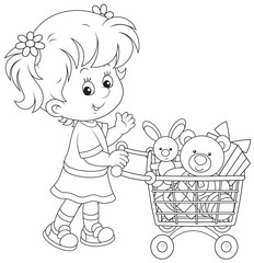 Girl with a shopping trolley of toys