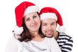 Happy couple smiles with Santa hats (clipping path)