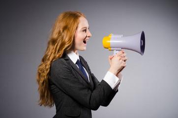Woman with loudspeaker in studio