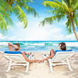 Loving couple relaxing on the beach
