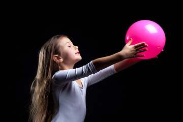 Emotional rhythmic gymnast dancing with ball