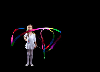 Artistic gymnast dancing with colorful ribbon