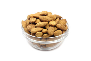 grain almonds in a glass cup isolated on white