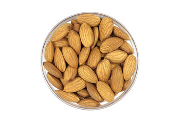 grain almonds in a glass cup on a white background