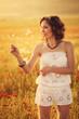 A woman in the poppy field