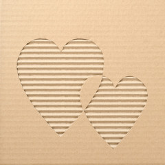 Hearts cut out on a corrugated cardboard
