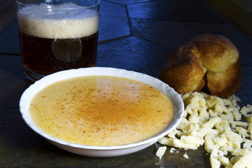 Beer Cheese Soup with Crumbled Cheese and Popover