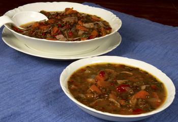 Beluga Lentil Soup in White Bowl and Tureen