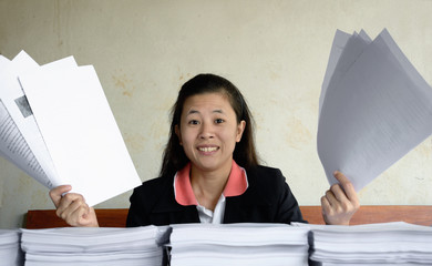 businesswoman frustrated and raise up papers into the air