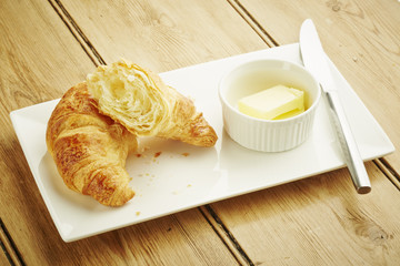 Croissant pastry on white dish