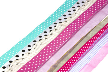 Rows of Textured Spotted Ribbons on White