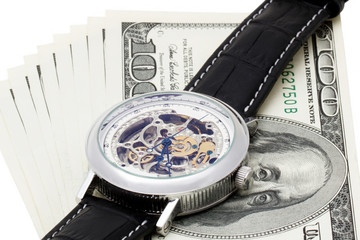100 dollars on white background with wristwatches