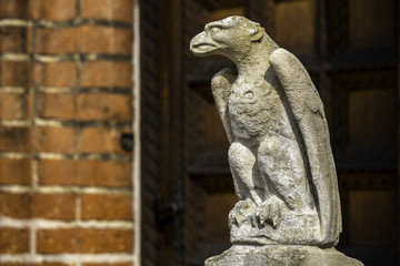 sculpture of a mythical bird at the entrance of a building