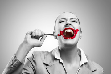 Conceptual Image with Vivid Red Mouth