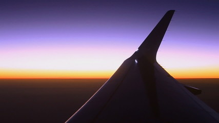 silhouette wing of airplane and twilight sky