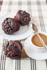Homemade chocolate muffins/buns with cup of coffee. Still life