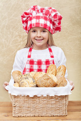 Happy baker holding a basket with fresh products
