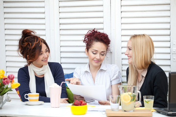 Three business women on a coffee break