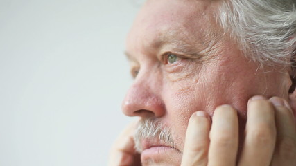 older man has dry, itchy skin on his face