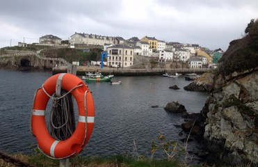 Life buoy at the seaport in Tapia, Spain