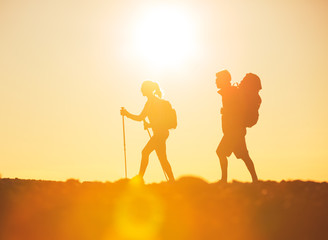 Hikers with Backpacks at Sunset