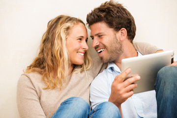 Young couple using tablet computer