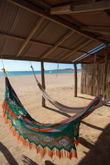 Colorful hammocks on a beautiful deserted bach