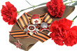Military cap with red flowers, Saint George ribbon, orders of Gr