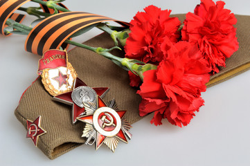 Military cap, red flowers, Saint George ribbon, orders of Great