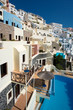 Traditional white Greek houses and swimming pools