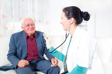 Doctor and male senior patient, home care