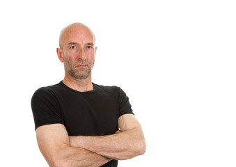 Man in black teeshirt posing with arms folded